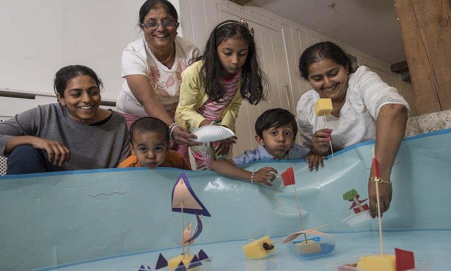 Families enjoy a watery workshop.