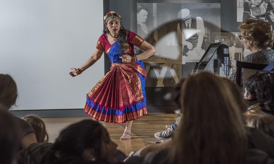 Visitors enjoy a storytelling performance.