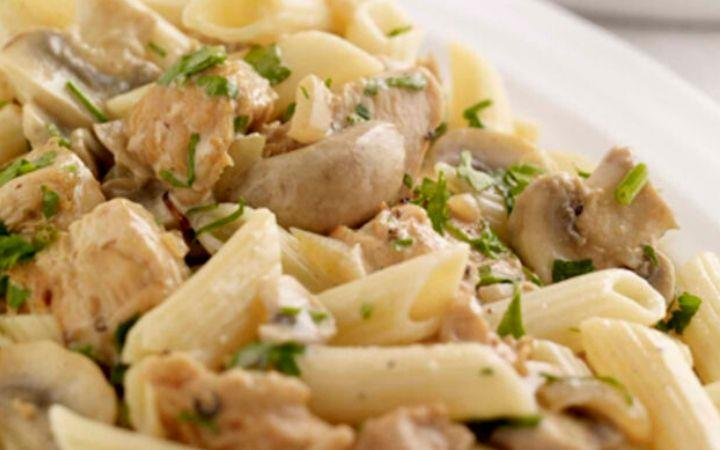 Chicken pasta and glass of wine - Aurora Orchestra image